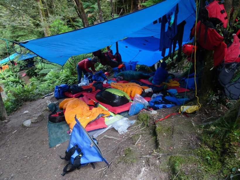 Room for eight - side by side under a tarp in the rain